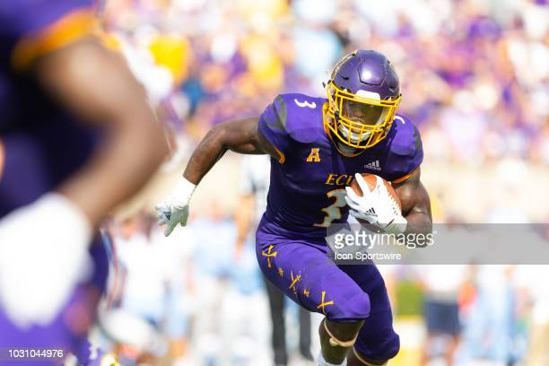 East Carolina Pirates running back Anthony Scott runs the ball during a game between the North Carolina Tar Heels and the East Carolina Pirates on...