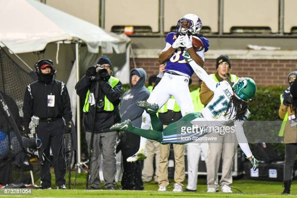 East Carolina Pirates wide receiver Davon Grayson leaps to catch the pass during a college football game between the Tulane Green Wave and the East...