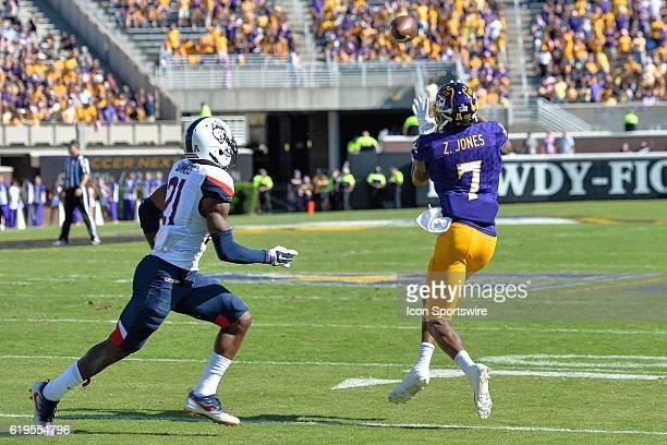East Carolina Pirates wide receiver Zay Jones catches a pass in front of Connecticut Huskies cornerback Jamar Summers in a game between the East...