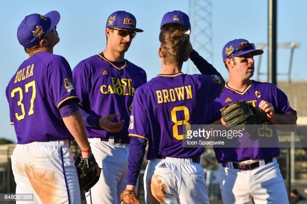 East Carolina pitcher Luke Bolka outfielder Spencer Brickhouse infielder Turner Brown and infielder Eric Tyler meet at third base in a game between...