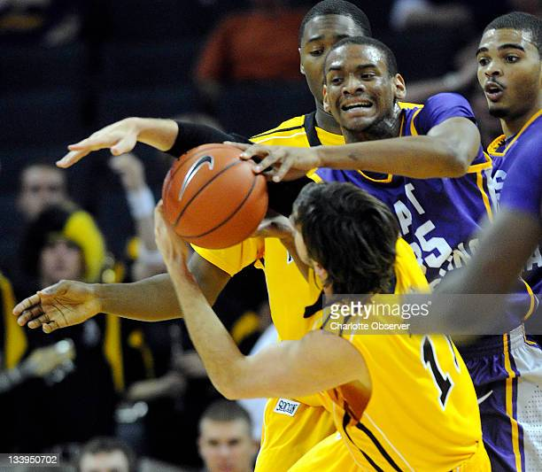 East Carolina's Darius Morales reaches out over Appalachian State's Nathan Healy for a loose ball during the first half of their game at Time Warner...