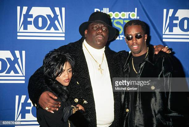 East Coast gangsta rapper Chris Wallace known as The Notorious BIG stands between songwriter Sean Puffy Combs and rapper Little Kim at the Billboard...