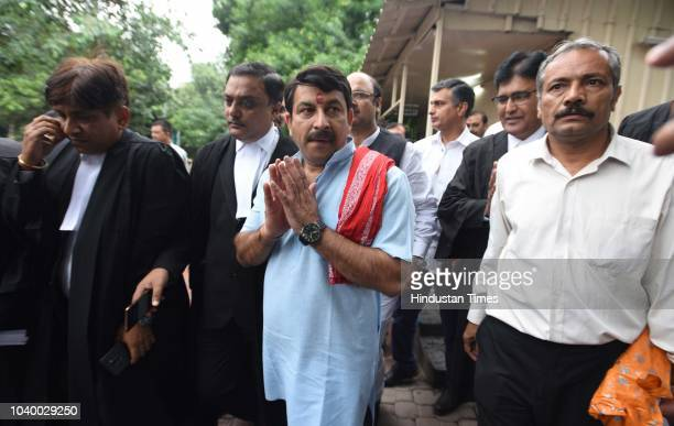 East Delhi MP and Delhi BJP Chief Manoj Tiwari arrives to appear at the Supreme Court in a case of breaking locks of a sealed house in East Delhi on...