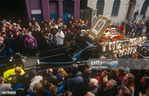 East End crowds flock at the funeral of notorious gangland brother Ronnie Kray on 29th March 1995 in Bethnal Green East London England