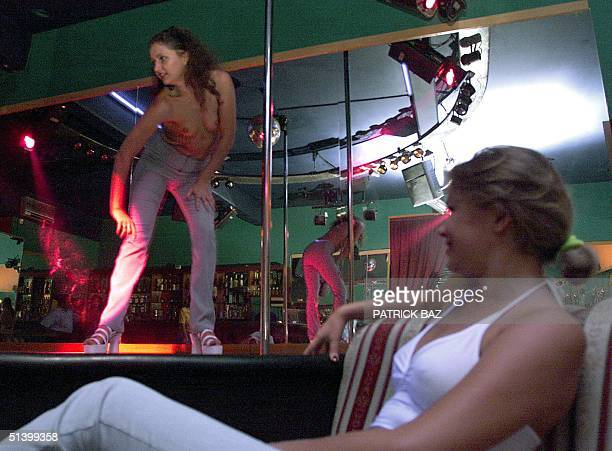 East European cabaret artiste performs her striptease show at one of Limassol's night clubs 12 September 1999 The southern town's Heros square in the...
