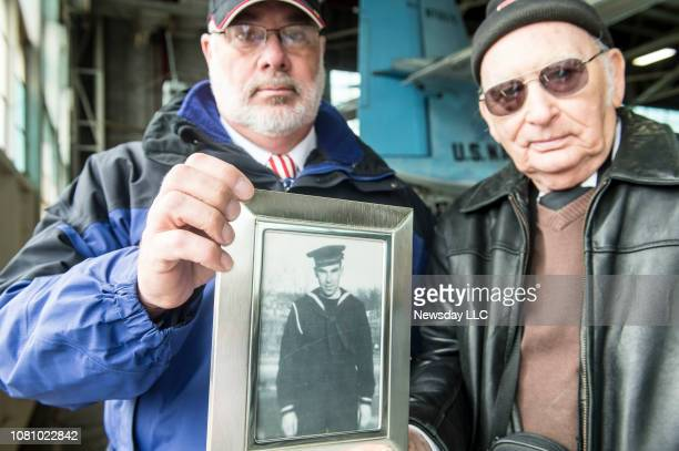 Ken Schultz and Gary Jayne hold a photo of their uncle Navy petty officer Kenneth Jayne on December 7 2016 Their uncle was killed on the Oklahoma...