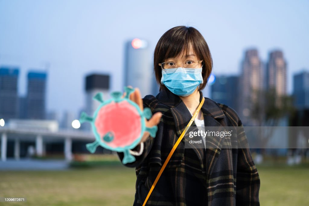 east female using mask protect from virus : Stock Photo