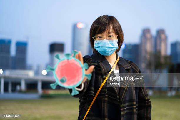 east female using mask protect from virus - wuhan stock pictures, royalty-free photos & images