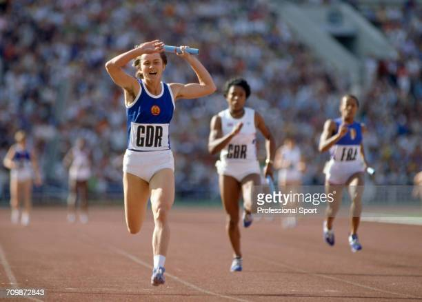 East German athlete Marlies Gohr crosses the finish line in first place to win the gold medal for the East Germany team ahead of Sonia Lannaman of...