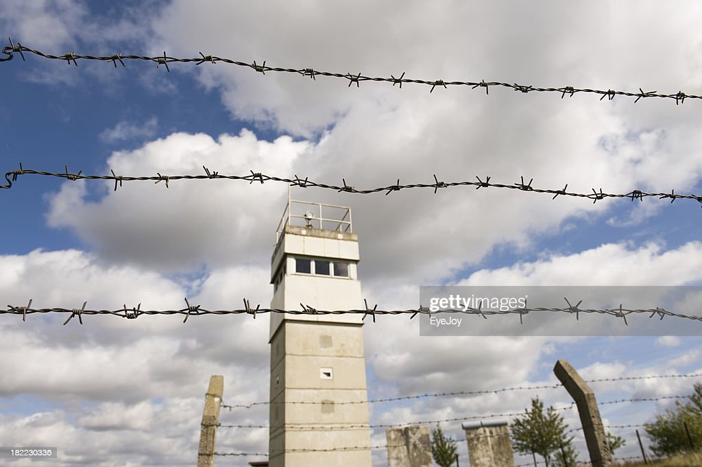 East German Barbed Wire Fence And Guard Tower Stock Photo | Getty Images