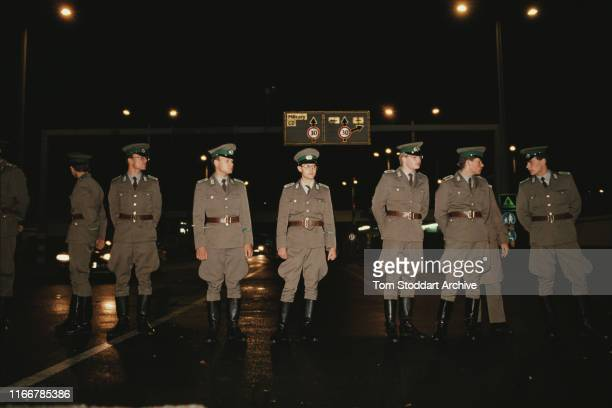 East German border guards on duty at Checkpoint Charlie on Friedrichstrasse on the night the border between East and West Berlin was opened, 10th...