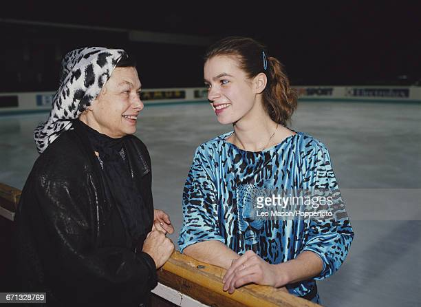 East German figure skater Katarina Witt pictured together with her coach Jutta Muller at the 1988 European Figure Skating Championships in Prague,...