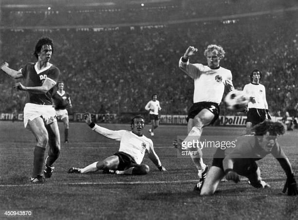 East German forward Juergen Sparwasser scores the winning goal past West German defenders Horst Hoettges Berti Vogts and goalkeeper Sepp Maier 22...