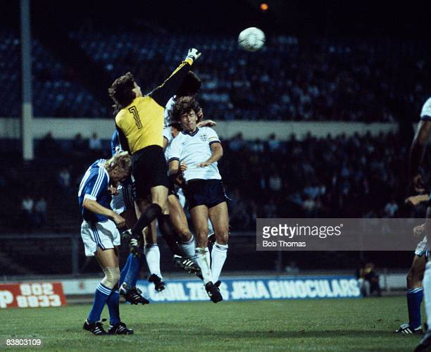 East German goalkeeper Rene Muller punches the ball away under pressure from England's Bryan Robson and Paul Mariner at Wembley Stadium 12th...