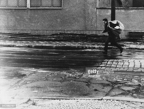 East German man trying to escape to West Berlin at Zimmerstrasse shortly after the beginning of the construction of the Berlin Wall