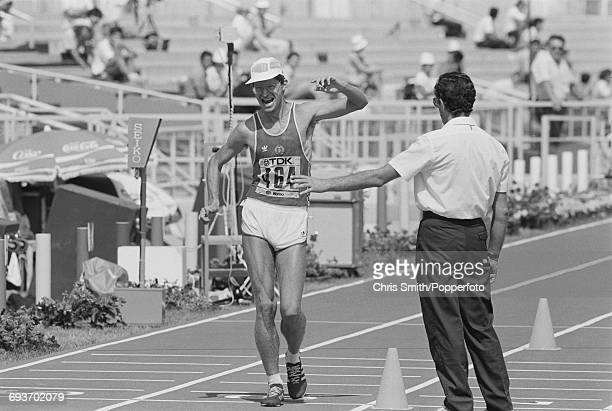 East German race walker Hartwig Gauder crosses the finish line in first place to win the gold medal in the Men's 50 kilometres walk event at the 1987...