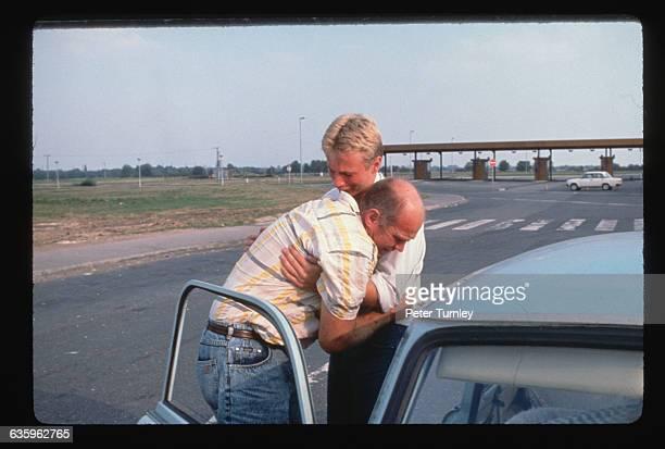East German Refugess Reuniting on Street at Border