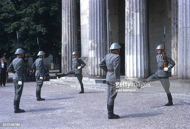 East German soldiers goose step during changing of the guard ceremony at the Neue Wache in East Berlin which the 1960's was a memorial for facism and...