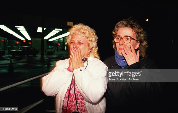 East German women cry with joy as they cross to freedom from East Berlin to the west through Checkpoint Charlie on the night of November 9th 1989...