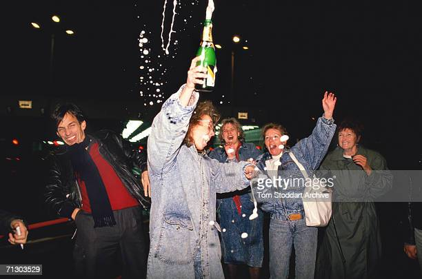 East Germans celebrate joyfully as they cross to freedom from East Berlin to the west through Checkpoint Charlie on the night of November 9th 1989...