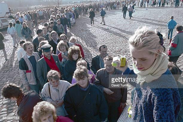 East Germans wait in line for food handouts in West Berlin