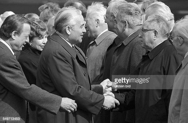 SED officials members of the Politburo of the Central Committee of the SED party welcoming Mikhail Gorbachev General Secretary of the Communist Party...