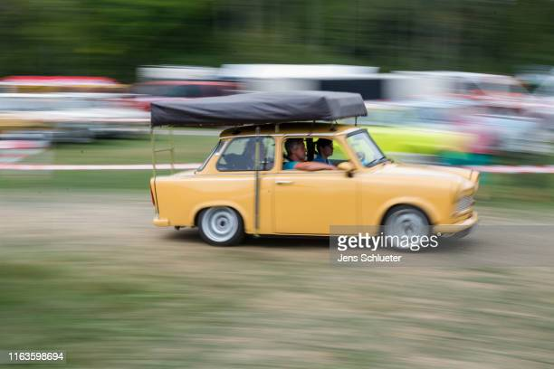 East Germanyera Trabant car moves at the annual gathering of Trabant enthusiasts on August 24 2019 in Zwickau Germany The humble Trabant or Trabi as...
