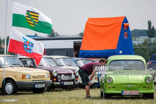 East Germanyera Trabant cars stand in a line at the annual gathering of Trabant enthusiasts on August 24 2019 in Zwickau Germany The humble Trabant...