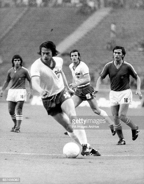 East Germany's Jurgen Sparwasser takes the ball forward watched by teammate Wolfgang Seguin and Chile's Carlos Reinoso and Guillermo Paez