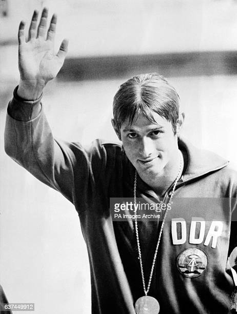 East Germany's Roland Matthes acknowledges the cheers of the crowd after receiving his gold medal for the men's 100m backstroke
