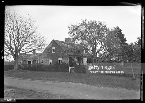 East Hampton, Long Island: unidentified rambling wood-shake house with gated hedgerow, New York, New York, late 19th or early 20th century.