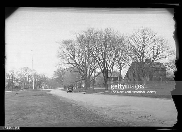 East Hampton, Long Island: unidentified wood-shake saltbox houses along an unpaved road, New York, New York, late 19th or early 20th century.