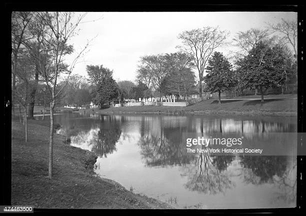 East Hampton, Long Island: view across East Hampton Town Pond to South-End burial ground cemetery, Houses visible beyond, New York, New York, late...