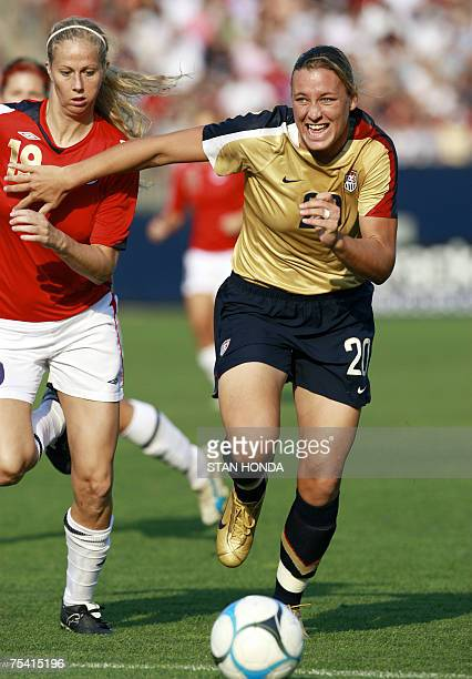 Abby Wambach of the US and Marit Christensen of Norway fight for ball during a friendly match 14 July 2007 in East Hartford Connecticut part of a...