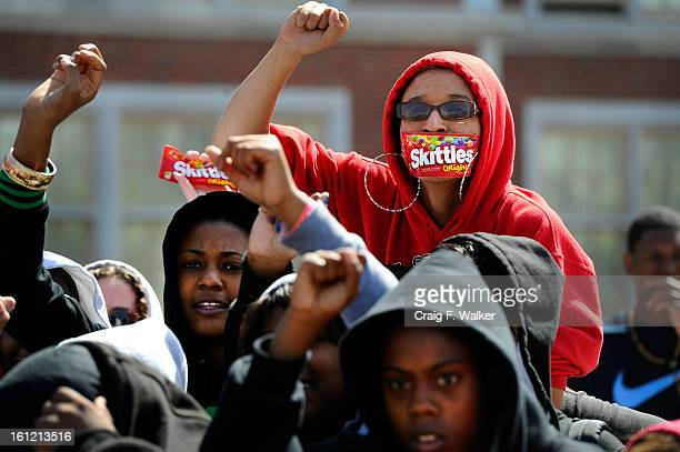 East High School senior Briana Exum wears a Skittles wrapper over her mouth during a group photo outside the school in Denver CO Tuesday April 10...