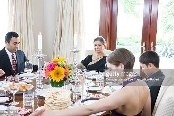 East Indian family praying before a meal