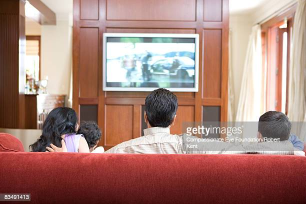 East Indian family watching television