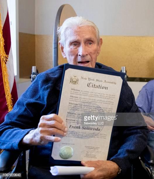 Frank Soliwoda a 100 yearold Long Island Army veteran poses as he was honored New York State Assemblyman Andrew Garbarino at Momentum at South Bay a...