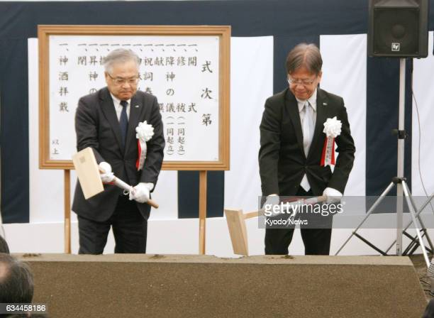 East Japan Railway Co President Tetsuro Tomita and Urban Renaissance Agency President Masahiro Nakajima attend a groundbreaking ceremony in Tokyo on...