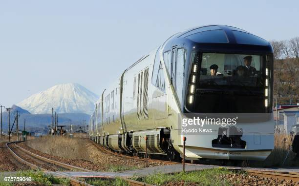 East Japan Railway Co's new luxury sleeper train Train Suite Shikishima runs on May 2 in Date Hokkaido with Mt Yotei in the background The train...
