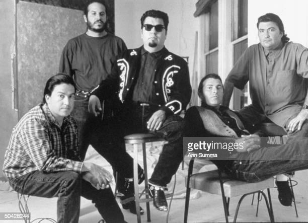East L A quintet band Los Lobos sitting on stools Conrad Lozano Steve Berlin Cesar Rosas Louie Perez David Hidalgo