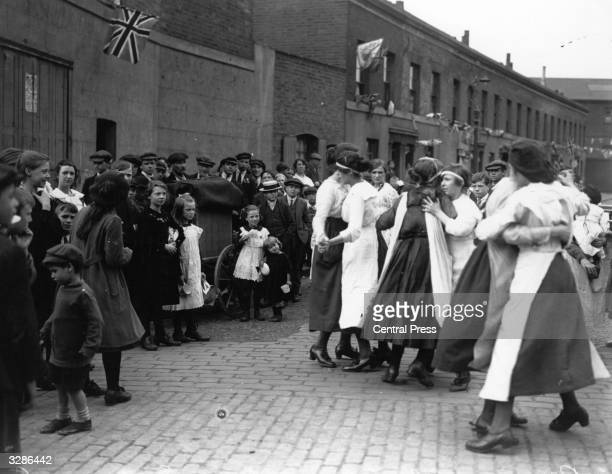 East London residents dancing at a street party to mark the end of the First World War