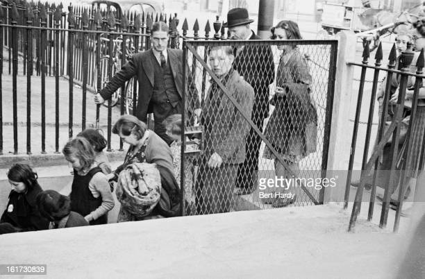 East Londoners enter a basement shelter in the first month of the Blitz September 1940 Original publication Picture Post 297 East End At War pub 28th...