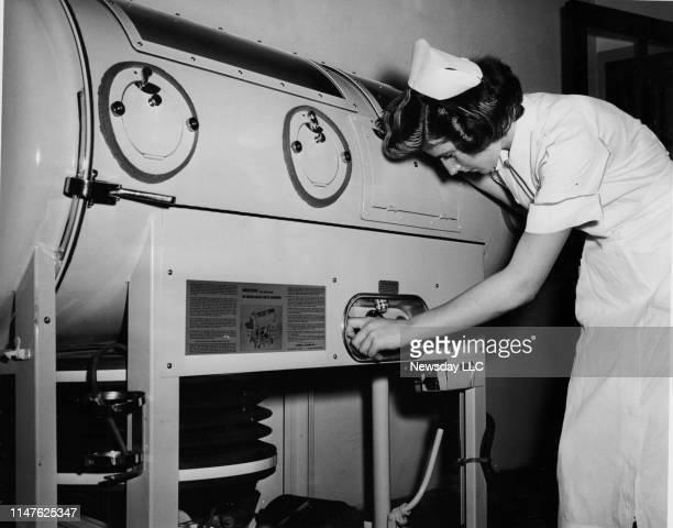Sara Sheard RN a staff nurse at Meadowbrook Hospital in East Meadow New York examines one of the three iron lungs brought to the facility to deal...
