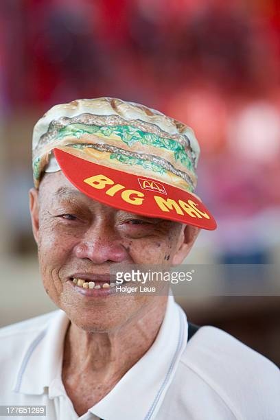 east meets west: chinese man with big mac cap - big mac stock pictures, royalty-free photos & images