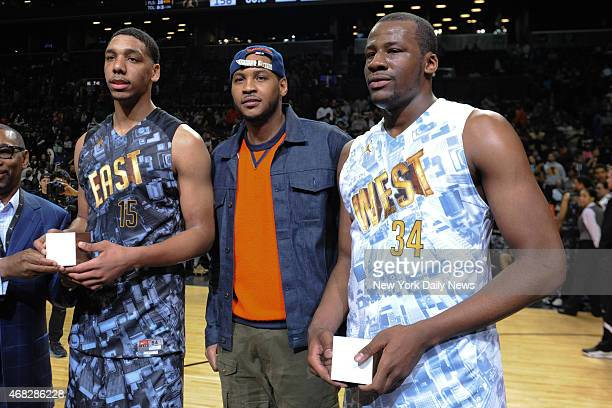 East MVP Jahill Okafor N ew York Knicks Carmelo Anthony and West MVP Cliff Alexander with trophy's after game action of the 2014 Jordan Brand Classic...