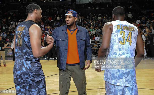 East MVP Jahill Okafor New York Knicks Carmelo Anthony and West MVP Cliff Alexander with trophy's after game action of the 2014 Jordan Brand Classic...