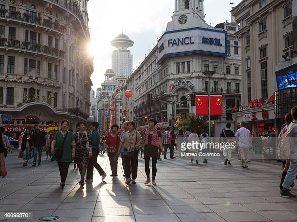 CONTENT] East Nanjing road main shopping and touristic street in the centre of Shanghai crowded with people at sunset Shanghai China