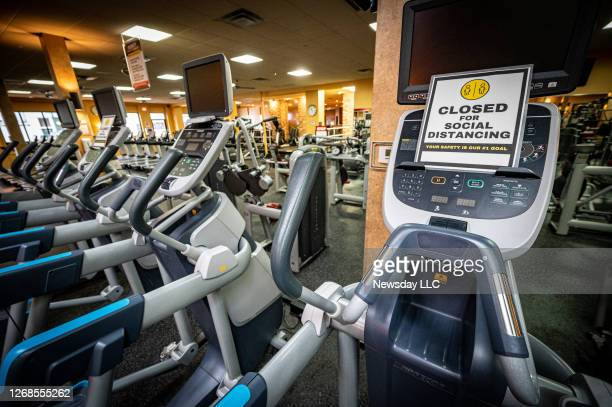 Signs are posted regarding social distancing on machines throughout the facility at Gold's Gym in East Northport on Aug. 19, 2020 ahead of reopening...