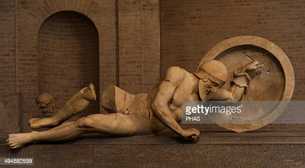 East Pediment's Group of the Temple of Aegina Ca 490 BC First battle of Greeks and Trojans Dying warrior probably Laomedon Glyptothek Museum Munich...
